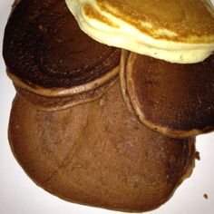 Nutella Pancakes and one regular pancake! So yummy, Baby Scott loved them! I just followed the pancake recepie on the Bisquick box and separated some batter into another bowl and added over a tablespoon of Nutella.. Not really anything exact and it came out yummy!