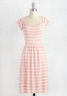 Quaint the Town Dress  Guided by your passion for penny candy, you drift through town in this pink and white dress. As sweet as the treats your crave, the cap sleeves, mirrored square neckline and backline, and striped print of this heather knit frock have all the charm of your old-fashioned fandom. The post  Quaint the Town Dress  appeared first on  Vintage & Curvy .  http://www.vintageandcurvy.com/product/quaint-the-town-dress