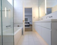 Nice all white bath.  Modern Bathroom Floor Tile Design, Pictures, Remodel, Decor and Ideas - page 56