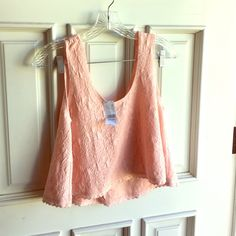 Crop Top❗️❗️❗️FLASH DEAL❗️❗️❗️ Adorable pink crop! Great for Spring and Summer! New and still has tags!  This is perfect for your swimsuit, jeans, shorts, and more❗️ LA Hearts Tops Crop Tops