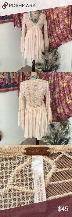 Free People dress Lovely Free People dress with lace and bell sleeves. Beautiful front button details. Free People Dresses Mini