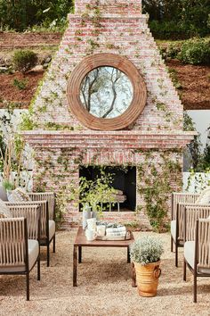 Julianne Hough Gives Her Outdoor Space a Chic Makeover: The gorgeous brick fireplace certainly adds rustic drama to Hough's outdoor space.