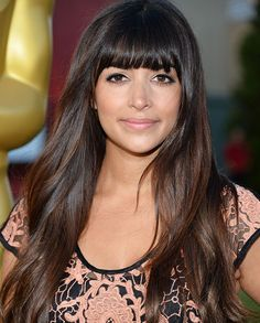Famous Actress Hannah Simone From Fox Channel's New Girl Tv Show With Her Brown Hairs,Bronzed Skin,gorgeously lined eyes lip/lipstick.