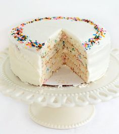 Do you love sprinkles in your birthday cake? Was the classic Pillsbury Funfetti cake mix your very favorite? Funfetti cakes were a staple of childhood birthday parties, but I haven't had one in a long time — probably because I don't really use boxed cake mixes anymore. I realized, though, that it is still a snap to make a Funfetti cake. Just add sprinkles!