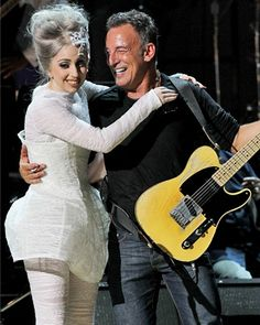 Lady Gaga embraces Bruce Springsteen at the Rainforest Fund's annual benefit on May 13, 2010.