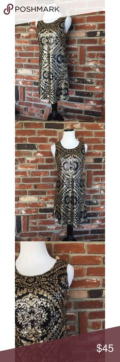 "Miami Sequins ALine Exposed Zipper Dress S This is a gorgeous black with gold Sequins Miami ALine dress size Small. Lined. Back exposed zipper. Measured laying flat: bust 17""/ waist 17""/ hips 20""/ dress length 33.5."" Gently used and in great condition. Hand wash and flat dry. 100% poly blend material. 082917 Dresses Midi"