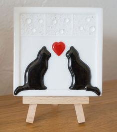 This is a beautiful small fused Glass Picture on a Wooden Easel of 2 black Cats sitting on a Window with a red Heart handmade by my Husband Mark John