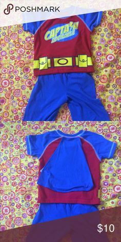 Captain Adorable superhero style pajamas 18 mos Your little superhero will be adorable in this pajama set by Carter's. Detachable cape velcros to the back. Nice enough to go out in. Excellent condition Carter's Matching Sets