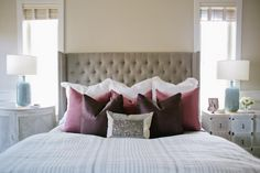 This dreamy master retreat exudes a calm color palette with pops of plum, mauve and light blue in the accessories. A sequined pillow adds a touch of pizzazz to the bed.