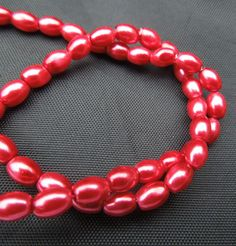 strand Red Glass Oval Rice Pearls Jewellery Making Beads x Jewelry Making Beads, Jewellery Making, Red Glass, Pearl Jewelry, Rice, Beaded Bracelets, Pearls, Chain, Board