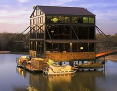 Go inside a glass house elevated atop pilings in the center of a four-acre lake in Round Top, Texas. Austin Homes, Texas Homes, Three Story House, Lake Texoma, Garage Door Styles, Floating House, Waterfront Property, Image House, Contemporary Architecture