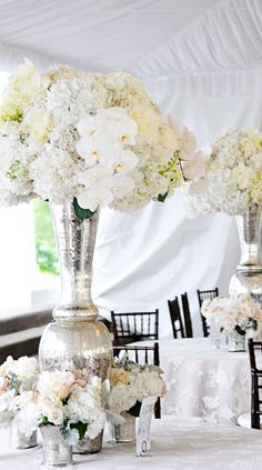 hydrangea and orchid white centerpiece with silver vases, love!
