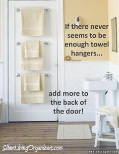Add towel hangers to the back of the door for more storage in the #bathroom.