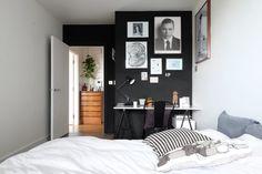 Black gallery wall. marble desk top.