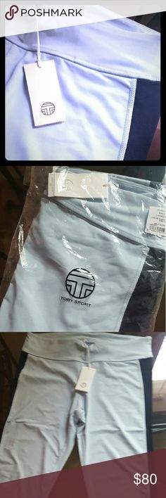 Tory burch yoga pants New! Never used yoga pants in baby blue with navy blue side stripe. They stop mid calf. Super cute. Tory Burch Pants Leggings