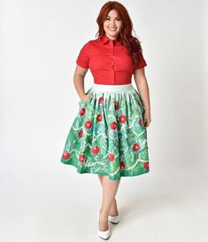 Festoon this adorable ornament to your feminine figure and leave the grinches behind! Freshly cut from Unique Vintage, a bough of snow-covered evergreen print features classic red printed ornaments and ringing golden bells that chime in time with your hol