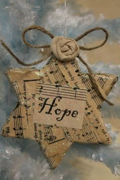 Cut cardboard, wrap in newspaper or sheet music or whatever you'd like, and punch a hole in the top for string!