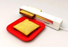 This is the coolest! Jaren Goh has created an innovative toaster design with the Rollertoaster