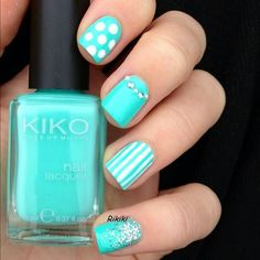 Gem studded and glitter nails for elegant short nails in this color.
