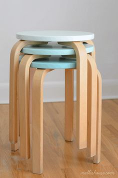 A couple of coats of paint can make your common IKEA finds totally unique and perfect for your unique home or apartment. These IKEA stools took on their own personality when painted in different shades of the same color.
