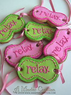 "Cookies for a ""spa theme"" party. My friend sent me a picture of a similar design. She wanted pink/green with the word ""relax"" and with the ribbon on the side. The only addition I added was the border of sanding sugar to give the cookies a sparkling effect.I made 16 of these. Really fun to make...just wish I had time to ""RELAX"" :)"