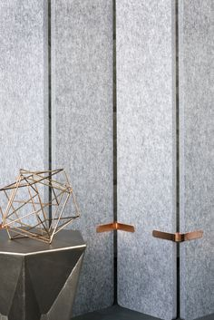 EchoPanel Grey 442 acoustic dividing screens with copper coloured joiners creates an appealing contrast in textures