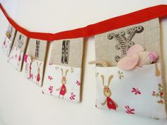 Bunny pocket bunting organiser  5 linen flags with cute bunny fabric pockets Can be personalised  Super sweet new baby gift READY TO SHIP. £16.90, via Etsy.