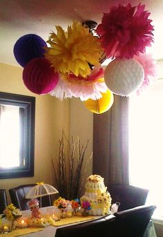 handmade pom pom flower decorations made for my daughter's baby shower :)