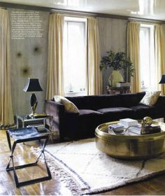 gold round coffee table- kind of love the bling to draw in foyer fixtures and kitchen hardware.
