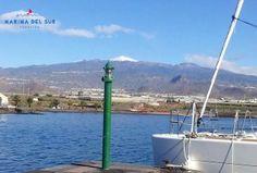 Our marina under the watchful eye of the majestic Mount Teide.  Nuestra marina bajo la atenta mirada del Teide nevado.