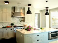 Put the spotlight on your kitchen's design with lighting that enhances its features and style. Browse these photos for inspiration.