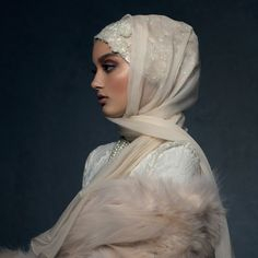 Elevate your look with the Ethereal Ivory hijab. Pure silk crepe chiffon drapes like a dream over the glittering caplette, with intricate sequins, beads, pearls and face-framing floral lace appliq...