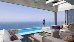 Opera Penthouse with Armani Casa Decoration, Netanya Israel.  Modern Luxurious Living Area Interior With Wicker Rattan Sofa Suite Sets And Infinity Poolside Terrace, Glass Railing Fence Luxury Beachside