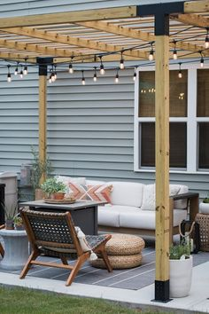 Turning a Basic Concrete Patio into A Pretty Patio with a Modern Pergola