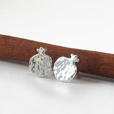 Pomegranate stud earrings , Sterling silver studs , hammered earrings , pomegranate jewelry ,Fruit jewelry, symbolizes blessing earrings  These pomegranate earrings are made in sterling silver (925) , They are tiny and suitable for everyday. They are NICKEL FREE ! #earrings #postearrings #studearrings #sigalitajd