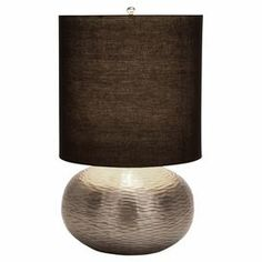 "Textured metal table lamp with drum shade.Product: Table lampConstruction Material: Metal and fabricColor: Silver and blackFeatures: UL listedAccommodates:  (1) 60 Watt max bulb - not includedDimensions: Overall: 23"" H x 14"" DiameterShade: 14"" DiameterCleaning and Care: Wipe with dry cloth"
