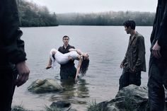 Klaus carries Cleo from the water after almost drowning as Max and Tex watch