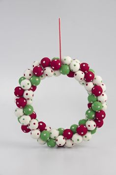 Welcome the festive season and your Christmas guests in style with a MOZI Christmas wreath.    Signature MOZI, this artful arrangement of felt baubles will bring a smile to your face and colour to your place. RRP $69.95
