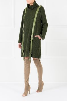 The military sweater dress receives a remarkable makeover at the hands of Concepto. The Romeo Reya dress is crafted from a deep olive-green melange wool and shaped with a roll neck, while the applied leather belts definitely make it a standout example. Knee-length boots will eloquently ground the look.