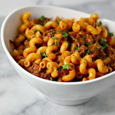 Braised Short Ribs are simmered in a rich flavorful tomato sauce and tossed with cavatappi pasta for a chic, comforting dinner.