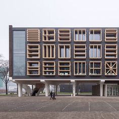 Geometric screens based on flag designs flank the windows of this former marine base in Amsterdam which Bureau SLA has converted into offices to mark the Dutch Presidency of the Council of the European Union. Read the full story on http://ift.tt/1qQA2k1 #architecture #Amsterdam #Netherlands Photography is by Milad Pallesh by dezeen