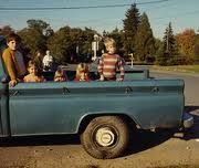 Riding in the back of a pick- up truck on a warm day was always a special treat...somehow we survived!