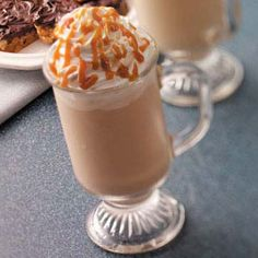 Frosty Caramel Cappuccino Recipe  Ingredients  1 cup half-and-half cream  1 cup 2% milk  3 tablespoons plus 2 teaspoons caramel ice cream topping, divided  2 teaspoons instant coffee granules  8 to 10 ice cubes  4 tablespoons whipped cream in a can