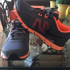 Nike dual fusion Dark grey and orange 6 in youth (7.5 in women's) Nike Shoes Sneakers