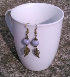 Toremore Crafts - taupe glass bead and bronze leaf charm earrings