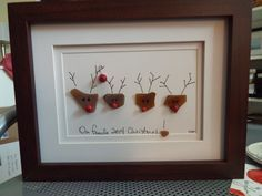 Sea Glass Reindeer - Our Family 2017 Christmas - an original design with 4 brown sea glass reindeer and a brown sea glass angel in a 7x9 brown shadowbox frame. This piece is entirely customize-able. You can add your familys last name and have your own familys mixture of male and female reindeer. Just let me know what your preferences are if customizing. As with all of my artwork, each piece is an original and once that piece is sold, I can create a custom duplicate - made to order and…