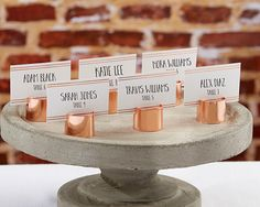 Help your guests find their seat at your industrial themed wedding with Kate Aspen's Copper Pipe Place Card Holders with coordinating copper striped place cards.