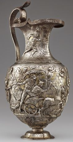 [Artefact] Pitcher with Scenes from the Trojan War, Roman, A.D. 1-100; silver and gold. Achilles dragging the body of Hector around the walls of Troy. [577X1129]