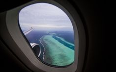 Changing airplane windows from square to round in shape was one of the most important innovations in aerospace design. Read on to find out why. Plane Window View, Airplane Window, Airplane View, Last Minute Travel, Cheap Plane Tickets, Travel Channel, Round Trip, Travel News, Travel And Leisure