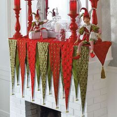 Christmas DIY: Bring cheer to your Bring cheer to your mantle this Christmas with the festive Kringle Mantel Scarf that features 13 vivid panels adorned with unique patterns. Christmas Bunting, Indoor Christmas Decorations, Christmas Mantels, Noel Christmas, All Things Christmas, Christmas Stockings, Whimsical Christmas, Christmas Fireplace, Christmas Colors